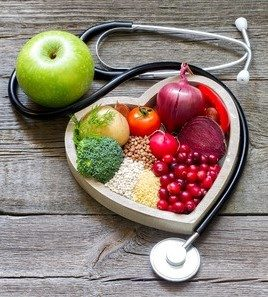48070183 - healthy food in heart and cholesterol diet concept on vintage boards