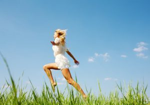 7409101 - photo of happy girl running down green grass on sunny day