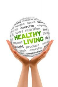 13962950 - hands holding a healthy living word sphere sign on white background.