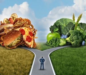 31451433 - diet decision concept and nutrition choices dilemma between healthy good fresh fruit and vegetables or greasy cholesterol rich fast food with a man on a crossroad trying to decide what to eat for the best lifestyle choice.